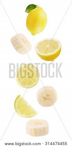 Floating Isolated On White Background Lemon Fruits And Bananas