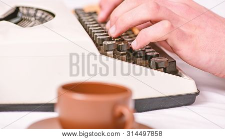 Old Typewriter And Authors Hands. Male Hands Type Story Or Report Using White Vintage Typewriter Equ