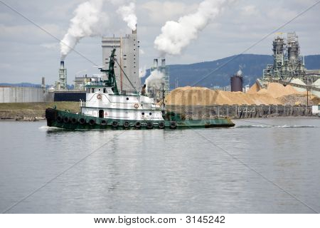 Tug On The River Near A Mill