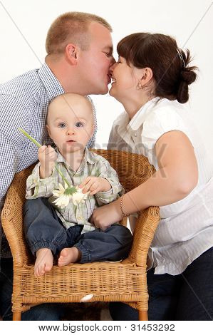 Happy Family With A Child.