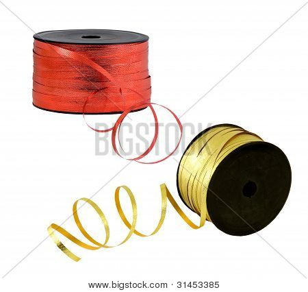 red and gold ribbon on a spool
