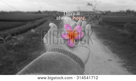 Hope Inspirational Motivational Quote - There Is Always Hope. With One Human Hand And Rural View Bac