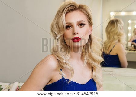 Fashion Portrait Beautiful Model Girl With Copy Space For Your Text. Medium Length Wave Blonde Hair.