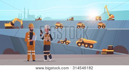 Engineers Using Radio And Tablet Workers Controlling Professional Equipment Working On Coal Mine Ext