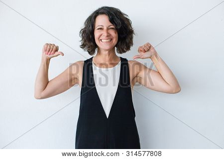 Cheerful Woman Pointing At Herself. Beautiful Confident Middle Aged Woman Pointing With Thumbs And S