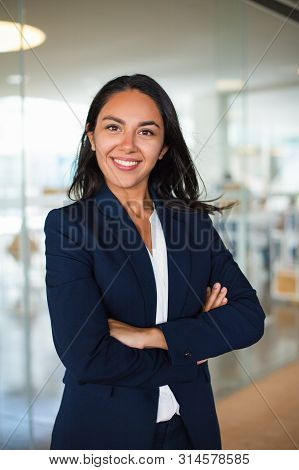 Confident Cheerful Young Businesswoman. Professional Business Woman Standing With Crossed Arms And S