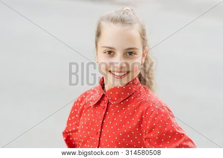 Innocent Beauty Of The Girl Child. Happy Girl. Cute Little Girl Smiling Outdoor. Small Girl With Blo