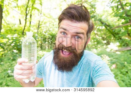 Thirst is everything. Thirsty man. Bearded man holding bottle of drinking water to quench his thirst. Thirst or dehydration. Thirst quenching. poster