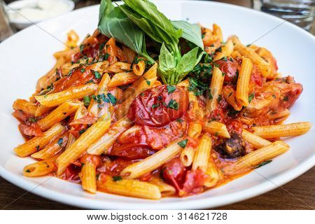 tasty pasta Italian tomato sauce pasta on the table