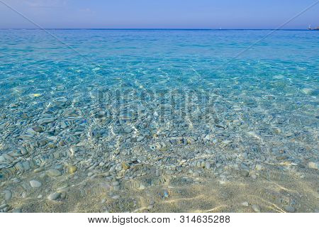 Sea View. Calm Azure Water With Light Overflows.