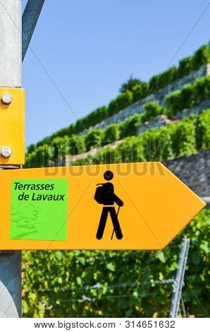 Vertical Picture Of Yellow Tourist Sign In French Saying Terraces Of Lavaux Giving Directions In Fam
