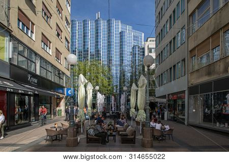 ZAGREB, CROATIA-APRIL 25, 2019: Tourists and locals at Bogoviceva street on a terrace of a coffee shop on a beautiful sunny day