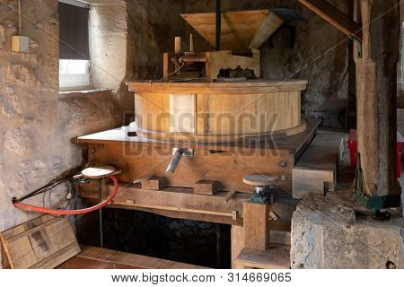 Traditional ancient and working water mill inside a home in France