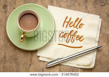 Hello coffee - cheerful handwriting on a napkin with a cup of coffee