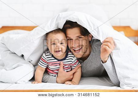 Boys Are Boys. Cheerful Baby Hiding Under Blanket With Father, Empty Space