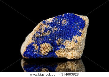 Raw Azurite Mineral Stone In Front Of Black Background, Mineralogy And Esotericism