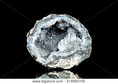 Raw Quartz Druse Or Geode Mineral Stone In Front Of Black Background, Mineralogy And Esotericism