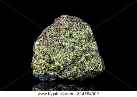 Raw Green Epidote Mineral Stone On Mother Rock  In Front Of Black Background, Mineralogy And Esoteri