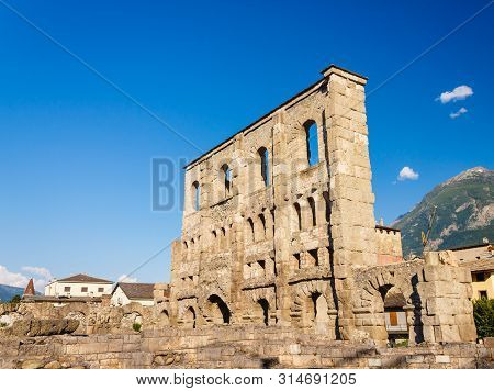 Aosta, Italy-june 17,2019: The Roman Theather Of Aosta Is Of Roman Period With A Facade Pierced By A