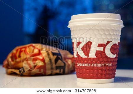 Minsk, Belarus - November 28, 2017: Burger And Paper Cup With Kfc Logo On Table In Kfc Restaurant