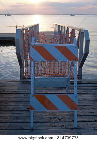 Vertical Orange And White Caution Sign On Dock