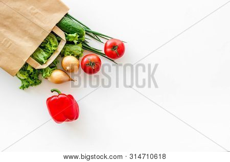 Healthy Food With Fresh Vegetables In Paper Bag On White Background Top View Space For Text
