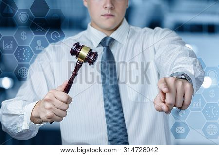 The Concept Of Auctions. The Auctioneer Conducts The Auction On Blurred Background.