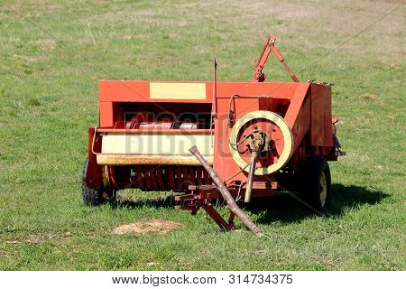Agricultural Farming Haymaking Equipment Left In Local Field After Heavy Usage Surrounded With Green
