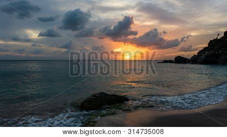 Travel Photo Of St. Barth's Island (st. Bart's Island), Caribbean. View Of A Peaceful Sunset And Wav