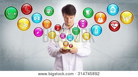 Young Male Doctor Accessing Many Apps On A Smartphone. Health Care Technology Concept For Telemedici