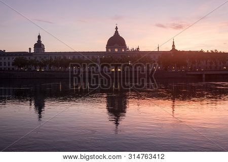 Hotel Dieu In Lyon, France, Taken From The Rhone Riverbank During An Evening Sunset. Hotel Dieu Is A