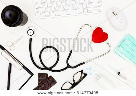 Stethoscope, Top View Of Doctor's Desk Table, Blank Paper On White Background, Above View Doctor Wor