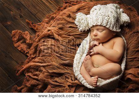 Sleeping Newborn Baby, New Born Kid Sleep In Hat, Studio Portrait On Brown Background, Child One Mon