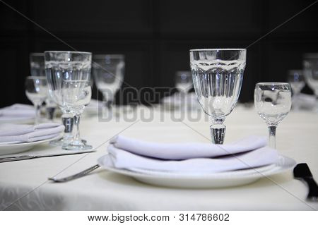 Table Setting In A Restaurant. Empty Glasses Set In Restaurant. Table Setting With Glasses, Cutlery