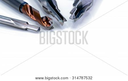 Special Tools Isolated On White Background. Made To Order Special Tools. Coated Step Drill And Reame