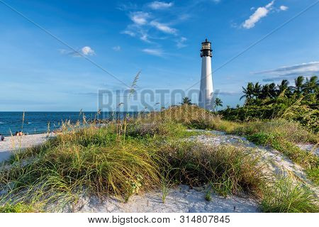 Beach Florida Lighthouse At Sunset. Cape Florida Lighthouse, Key Biscayne, Miami, Florida, Usa