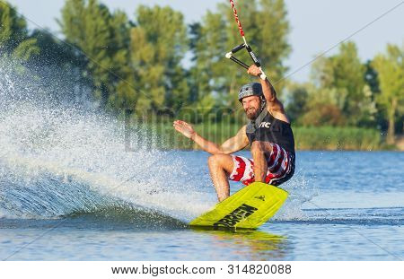 Cherkassy, Ukraine - July 19, 2019: Wakeboarder Showing Of Tricks And Skills At Wakeboarding Event I