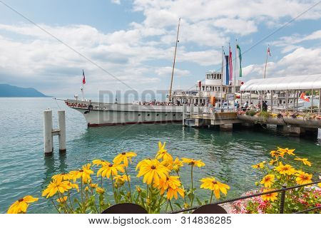 Montreux, Switzerland - July 15 2019: Passengers Embarking The Elegant Belle Epoque Restored Retro P