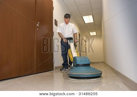 cleaning person polishing office hallway in commercial building poster