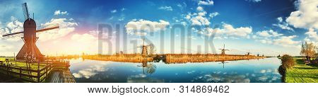 Traditional Dutch Windmills At Sunny Day, Netherlands. Nature Background