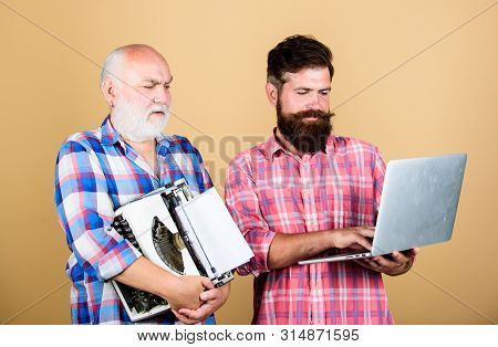 Renovation. Two Bearded Men. Vintage Typewriter. Youth Vs Old Age. Business Approach. Technology Bat