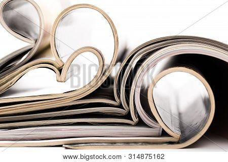 Selective Focus Of The Stacking Magazine Place On White Background. Colorful Abstract Background