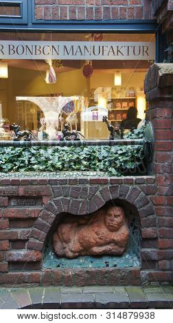 Bremen, Germany - 07 23 2015 - Shop Window Of Bremer Bonbon Manufaktur And Wall Decoration Sculpture