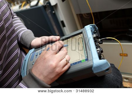 Maintenance Engineer Measuring Fibre Optic