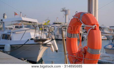 A Lifebuoy, Ring Buoy, Lifering, Lifesaver, Life Donut, Life Preserver On The Pier. Lifebuoy Mounted