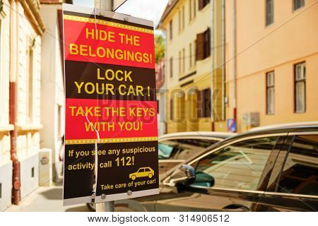 Sibiu, Romania - July 11, 2019: Warning Sign For Car Drivers To Protect Their Car And Belongings Aga