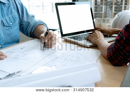 Engineer Or Architectural Project, Two Engineering Or Architect Discussing And Working On Blueprint