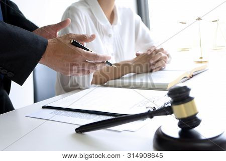 Judge Or Lawyer Talking  With Team Or Client