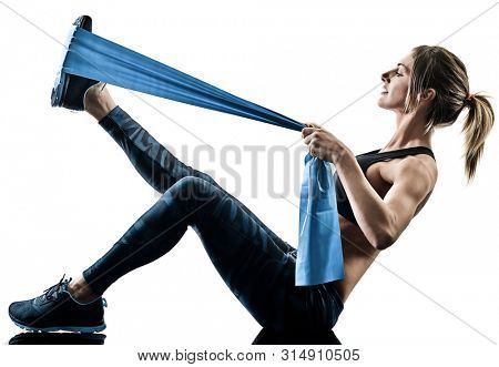 one caucasian woman exercising pilates fitness elastic resistant band exercises isolated silhouette on white background