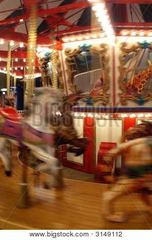 A Carnival carousel in motion with blur poster
